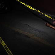 Body of a victim of an extrajudicial execution found on the road.