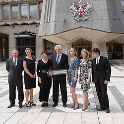© licensed to London News Pictures. LONDON, UK  13/06/2011. John Simpson (center), the BBC's World Affairs Editor, receives the Freedom of the City of London at the Guildhall today (Monday) for services to Broadcasting. Please see special instructions for usage rates. Photo credit should read CLIFF HIDE/LNP