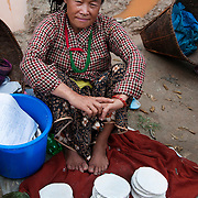 Nepal 2014. Khandbari. Market Day. Selling yeast cakes, used to ferment millet beer.