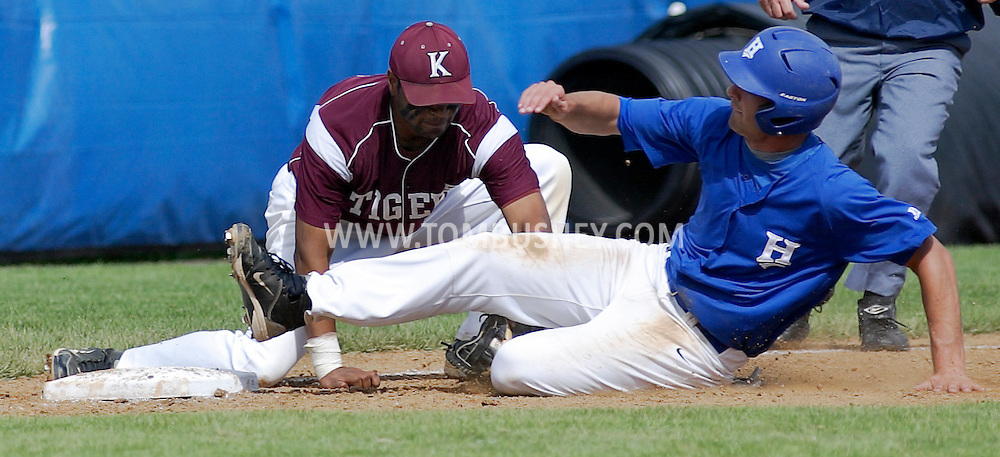 Kingston third baseman Chris Saitch tags out Mike Abrunzo of Horseheads during a state Class AA quarterfinal baseball game at SUNY New Paltz on Tuesday, June 5, 2012.