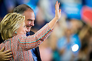 Hillary Clinton, presumptive 2016 Democratic presidential nominee, campaigns with Senator Tim Kaine (D-VA) at Northern Virginia Community College in Annandale, Va., U.S., on Thursday, July 14, 2016. Clinton and the former Virginia Governor discussed their shared commitment to building an America that is stronger together, while emphasizing that Donald Trump's divisive agenda would be dangerous for America. Kaine is considered to be the frontrunner for the Vice Presidential slot. Photographer: Pete Marovich/Bloomberg