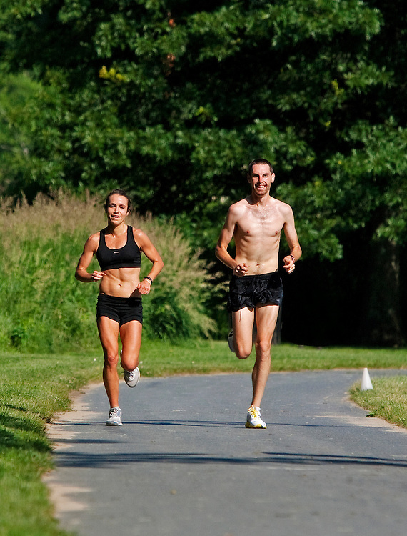 Zap Fitness athletes Alissa McKaig and Dave Jankowski go through a training run in Boone, NC. .