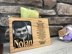 October 2, 2018 - Crown Point, IN, USA - On Sept. 19, 2016, Nolan Gold took his life. He was 19. This photo of him rests on a mantle in his family's home in Crown Point, Ind. (Credit Image: © Jerry Davich/Chicago Tribune/TNS via ZUMA Wire)