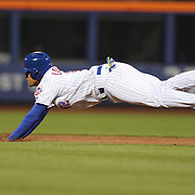NEW YORK, NEW YORK - APRIL 27:  Juan Lagares #12 of the New York Mets dives into second safely during the New York Mets Vs Cincinnati Reds MLB regular season game at Citi Field on April 27, 2016 in New York City. (Photo by Tim Clayton/Corbis via Getty Images)