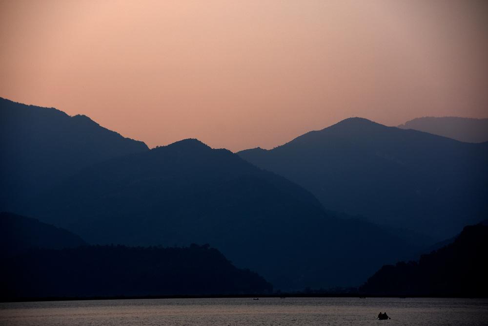 The hills and mountains at sunset over lake Pewa, Pokhara, Nepal