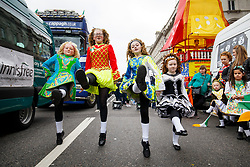 © Licensed to London News Pictures. 19/03/2017. London, UK. Irish dancers celebrate St Patrick's Day as a parade goes through the streets of central London on Sunday, 19 March 2017. Photo credit: Tolga Akmen/LNP