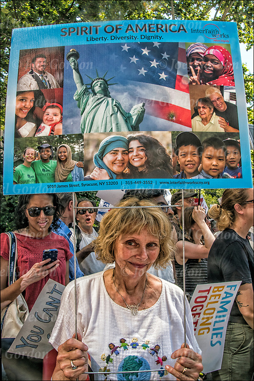 Protester holding up sign &quot;Spirt of America - Liberty, Diversity, Dignity&quot;  @ Foley Square and then across the Brooklyn Bridge before rallying in Cadman Plaza.<br /> <br /> Thousands are gathering in Manhattan &mdash; in one of about 750 planned marches around the country &mdash; to protest the Trump administration&rsquo;s rescinded policy of separating immigrant children and parents suspected of illegally crossing the U.S. border. <br /> <br /> Demand an end to President Trump&rsquo;s cruel &ldquo;zero tolerance&rdquo; policy and to support immigrant families in New York and across the country.<br /> <br /> Every day, this administration threatens the very future of our communities. The conditions these children are being subjected to is deplorable and un-American.