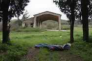 Abandoned sleeping bag in a forest by the Macedonian border. Evzonoi, Greece. March 24, 2016.