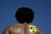 Guy with dreads, yellow sticker on his back, Ashton Court, 2006