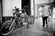 America, Cuba, Havana. A man walks in the streets of Havana, near an old motorcycle . -09.07.2008, DIGITAL PHOTO, 49MB, copyright: Alex Espinosa/Gruppe28