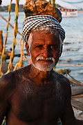 Portrait of a local fisherman at the old port of Kochi.