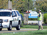 A fire policeman stands guard on Stump Road at the entrance after a shooting that left 27-year-old Robert Braxton dead and man that fired the shot being interviewed and cooperating with the police investigation Sunday April 24, 2016 at Keystone Fellowship Church in Montgomery Township, Pennsylvania. (Photo by William Thomas Cain)