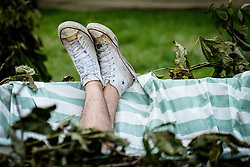 A person relaxing at the Brownstock Festival in Essex.