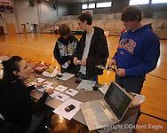 Lafayette High students (l. to r.) Jordan Langston, Tyler Darby, and Nathan Medlin meet with realtor Tina Taylor as part of career day at the school in Oxford, Miss. on Wednesday, February 24, 2010.