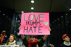 November 13, 2016 - Toronto, Canada - A group of Trump protesters, holding various banners, peacefully gather on 13 November in Toronto, Canada came to the streets to show solidarity with those who they think will be affected when Donald Trump takes over as the President of United States. People from the transgender, Indigenous and Black community gathered at Nathan Phillips Square and then marched towards the USA consulate to protest in front of it , in Toronto, Canada. (Credit Image: © Arindam Shivaani/NurPhoto via ZUMA Press)