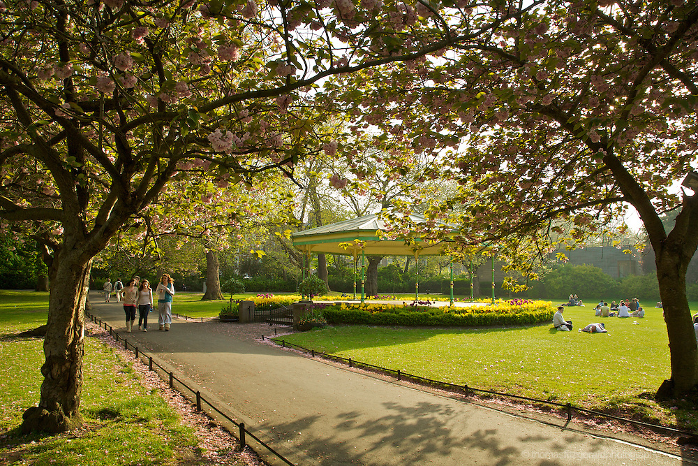 St. Stephen's Green, Dublin, Ireland: On a sunny summer evening, people relax in the park beside the famous band stand.