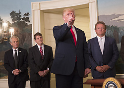 August 14, 2017 - Washington, District of Columbia, United States of America - United States President Donald J. Trump responds to a question from CNN reporter Jim Acosta after signing a memorandum addressing China's laws, policies, practices, and actions related to intellectual property, innovation, and technology at The White House in Washington, DC, August 14, 2017. .Credit: Chris Kleponis / Pool CNP (Credit Image: © Chris Kleponis/CNP via ZUMA Wire)