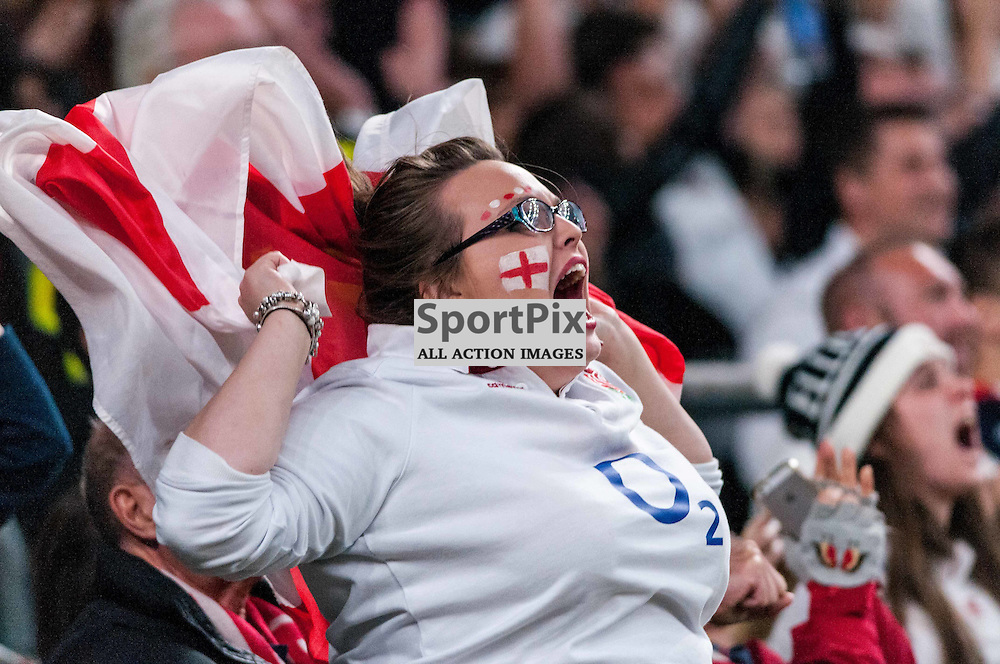 An England fan celebrates her team's opening try. Action from the England v Australia game in Pool A of the 2015 Rugby World Cup at Twickenham in London, 3 October 2015. (c) Paul J Roberts / Sportpix.org.uk