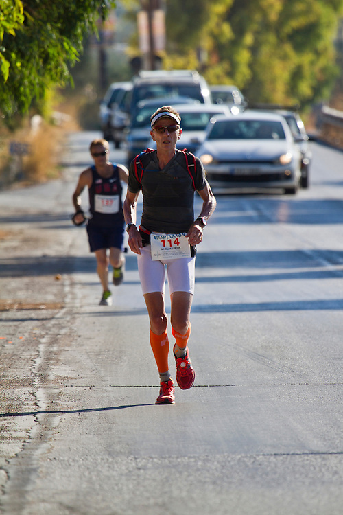 September 27 2013, Greece - Jan-Albert Lantink from Netherlands running during the 31st Spartathlon marathon, a historic ultra-distance foot race that takes place each September in Greece. Over 330 long distance runners from 35 countries followed the footsteps of ancient Athenian long distance runner Pheidippides and crossed 246 kilometers from Athens to Sparta during this year&rsquo;s race on 27-28 September 2013.<br /> <br /> The Spartathlon revives the footsteps of Pheidippides, an ancient Athenian long distance runner, who in 490 BC, before the battle of Marathon, was sent to Sparta to seek help in the war between the Greeks and the Persians. According to the ancient Greek historian Herodotus, Pheidippides arrived in Sparta the day after his departure from Athens.