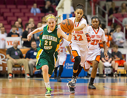 Greenbrier East guard Katherine Walton (21) and South Charleston guard Taliah Cashwell (12) run for a ball during a first round game at the Charleston Civic Center.