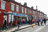 Fans arrive at the Oak Stand entrance to the Kenilworth Road stadium, which is nestled amongst residential dwellings, ahead of the Skrill Conference Premier match at Kenilworth Road, Luton<br /> Picture by David Horn/Focus Images Ltd +44 7545 970036<br /> 21/04/2014