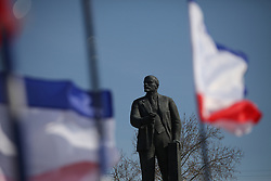 Crimean flags waving in a pro Russian rally with the statue of Lenin  at Simferopol's Lenin Square on March 15, 2014