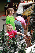 Ella Busse, 3 of Alexandria, Kentucky adds some snow as the Huntington Holiday Train display setup nears completion at the main branch of the Columbus Metropolitan Library in downtown Columbus, Sunday, November 25, 2012..The trains are setup by Applied Imagination on Saturday and Sunday and will run through mid-January.