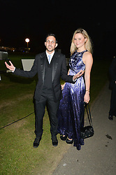 DYNAMO (Steven Frayne) and AMBER ATHERTON at the Chovgan Twilight Polo Gala in association with the PNN Group held at Ham Polo Club, Petersham Close, Richmond, Surrey on 10th September 2014.