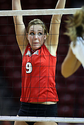 11 October 2008: Katie Culbertson keeps her arms up as she moves left and right along the net anticipating the point of attack during a match between the Bulldogs of Drake University and the Redbirds of Illinois State University.  The Redbirds took the match against the Bulldogs 3 sets to none on Doug Collins Court inside Redbird Arena on the campus of Illinois State University in Normal Illinois.