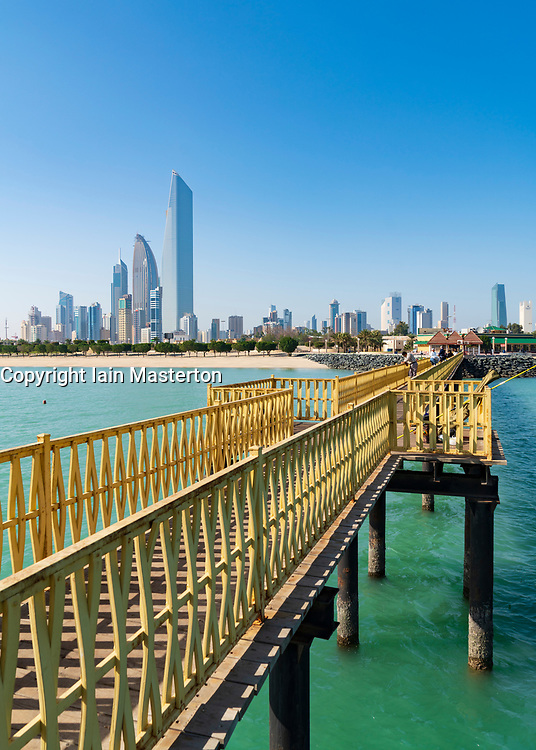 Skyline of modern office towers in downtown CBD from public pier in Kuwait City in Kuwait