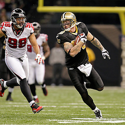 2009 November 02: New Orleans Saints tight end Jeremy Shockey (88) runs away from Atlanta Falcons defensive end Jamaal Anderson (98) during a game at the Louisiana Superdome in New Orleans, Louisiana.