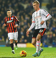Jack Grimmer of Fulham (right) and Adrian Colunga of Brighton and Hove Albion (left) during the Sky Bet Championship match at Craven Cottage, London<br /> Picture by David Horn/Focus Images Ltd +44 7545 970036<br /> 29/12/2014