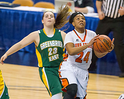 South Charleston guard Shy'Anne Dunham (24) drives to the hoop for a layup against Greenbrier East during a first round game at the Charleston Civic Center.
