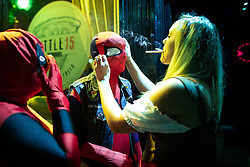© Licensed to London News Pictures . 26/12/2018. Wigan, UK. A woman adjusts a man's Spiderman costume outside a pub on Wallgate . Revellers in Wigan enjoy Boxing Day drinks and clubbing in Wigan Wallgate . In recent years a tradition has been established in which people go out wearing fancy-dress costumes on Boxing Day night . Photo credit: Joel Goodman/LNP