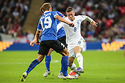 England's Ross Barkley takes on Estonia defender Ken Kallaste during the UEFA European 2016 Qualifier match between England and Estonia at Wembley Stadium, London, England on 9 October 2015. Photo by Shane Healey.