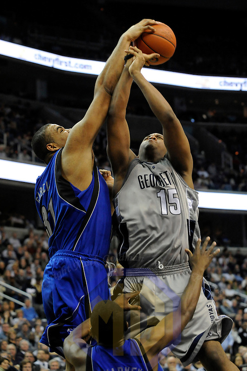 02 February 2008:   Seton Hall Pirates forward John Garcia (31) fouls Georgetown University Hoyas guard Austin Freeman (15) in the 1st half at the Verizon Center in Washington, D.C.  The Hoyas defeated the Seton Hall Pirates 73-61.