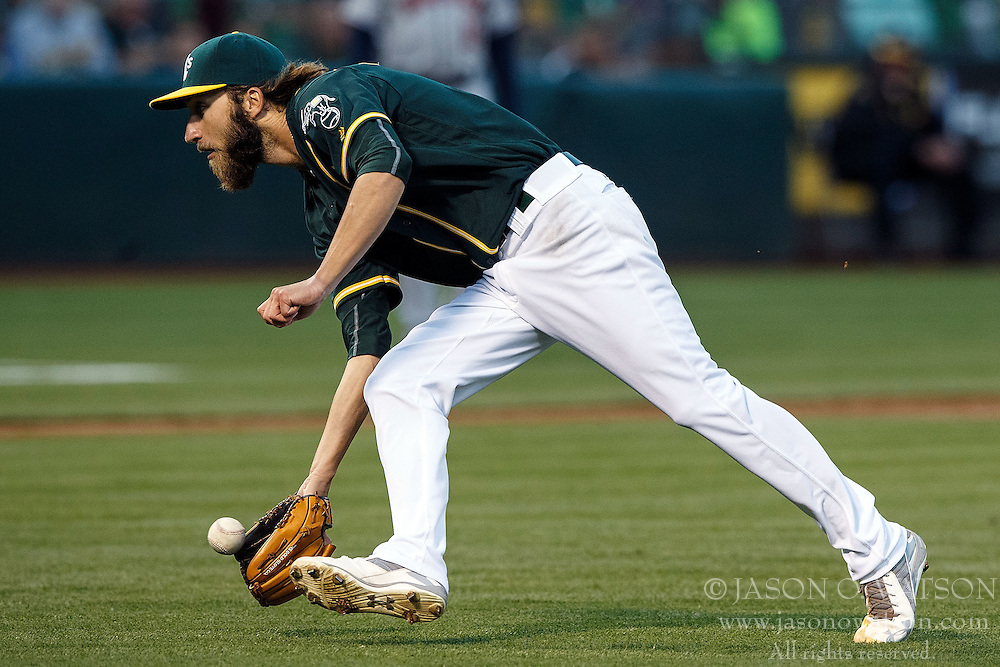 OAKLAND, CA - JULY 19:  Dillon Overton #47 of the Oakland Athletics fields a ground ball during the third inning against the Houston Astros at the Oakland Coliseum on July 19, 2016 in Oakland, California. The Oakland Athletics defeated the Houston Astros 4-3 in 10 innings.  (Photo by Jason O. Watson/Getty Images) *** Local Caption *** Dillon Overton