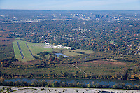 Aerial photo of Cornelia Fort Airpark in Nashville Tennessee showing the Downtown skyline and the Cumberland River.