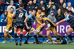 Jordan Williams of Bristol Rugby is tackled by Macauley Cook of Cardiff Blues - Rogan Thomson/JMP - 21/01/2017 - RUGBY UNION - Cardiff Arms Park - Cardiff, Wales - Cardiff Blues v Bristol Rugby - EPCR Challenge Cup.
