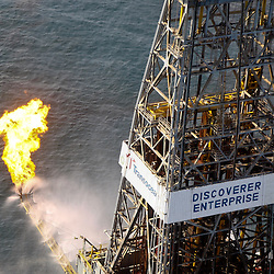 The drill ship Discoverer Enterprise burns off gas brought up from the cap placed over the damaged well, also some oil is reportedly being pumped up to the ship from the damaged well head in the Gulf of Mexico near the coast of Louisiana, U.S., on Saturday, June 5, 2010. The biggest oil spill in U.S. history, which began when BP Plc's Deepwater Horizon rig exploded on April 20, has soiled about 140 miles (225 kilometers) of coastline, halted new exploratory deep-water drilling in the Gulf and shut down a third of its fishing areas. Photographer: Derick E. Hingle/Bloomberg
