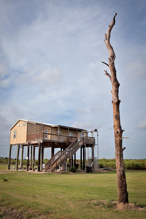Raised home on Isle de Jean Charles in Terribone Parish Louisiana. The Island is under constant threat of flooding due to coastal erosion.