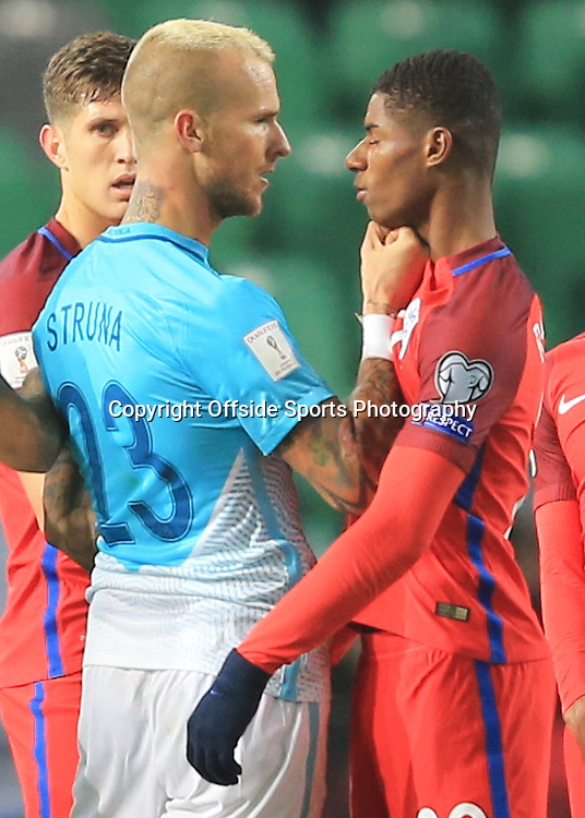 11 October 2016 - FIFA 2018 World Cup Qualifying (Group F) - Slovenia v England - Aljaz Struna of Slovenia puts his fist into the throat of Marcus Rashford of England  - Photo: Marc Atkins / Offside.