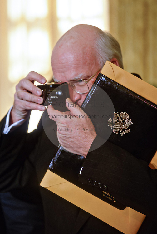 US Senator Patrick Leahy of Vermont takes a picture during an event in the Oval Office of the White House December 15, 1997 in Washington, DC.