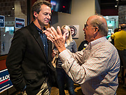 12 SEPTEMBER 2019 - CLIVE, IOWA: Governor STEVE BULLOCK (D-MT), left, talks to TIM URBAN after a campaign event in a microbrewery in Clive, IA, a suburb of Des Moines. Gov. Bullock is vying to be the Democratic party's nominee in 2020. He is campaigning in Iowa this week because he didn't qualify for the September 12 debate. Iowa traditionally hosts the the first election event of the presidential election cycle. The Iowa Caucuses will be on Feb. 3, 2020.              PHOTO BY JACK KURTZ