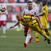 Eric Gehrig, Columbus Crew, heads clear during the New York Red Bulls Vs Columbus Crew, Major League Soccer regular season match at Red Bull Arena, Harrison, New Jersey. USA. 12th July 2014. Photo Tim Clayton