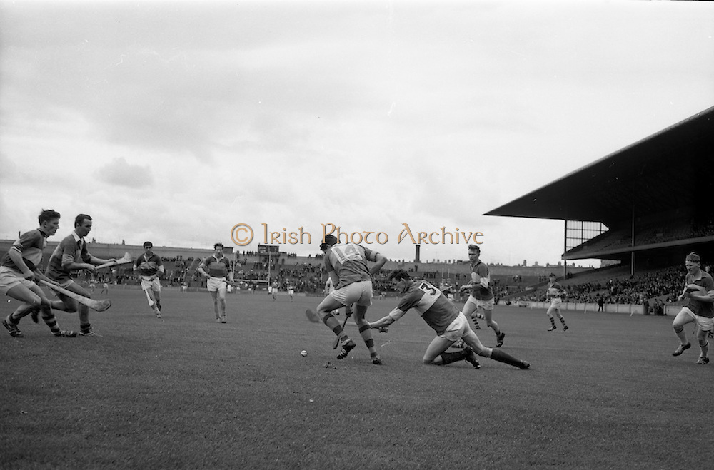 16/05/1965<br /> 05/16/1965<br /> 16 May 1965<br /> National Hurling League Final: Kerry v Laois at Croke Park, Dublin.<br /> On the right, Laois defender, L. O'Mahony (3), is on his knees but keeps with Kerry forward, T. Driscoll (14) to prevent a shot at a goal.