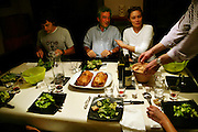 (MODEL RELEASED IMAGE) Friends gather for a dinner party with en croute in an apartment in Paris, France. (Supporting image from the project Hungry Planet: What the World Eats)
