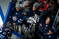 PENTICTON, CANADA - SEPTEMBER 9: Jamie Phillips #50 stands on the bench with Mikhail Berdin #60 of Winnipeg Jets during the final minutes of third period against the Edmonton Oilers on September 9, 2017 at the South Okanagan Event Centre in Penticton, British Columbia, Canada.  (Photo by Marissa Baecker/Shoot the Breeze)  *** Local Caption ***