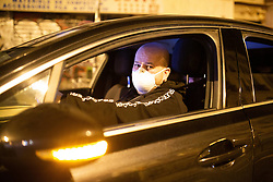 A uber driver drives with a Mask to be protected from the coronavirus. The street of rue du faubourg saint denis at midnight with bar closing in Paris, on March 14, 2020. France on March 14, 2020 drastically stepped up its measures against the spread of the coronavirus, announcing the closure of all non-essential public places including restaurants, bars and cafes from midnight. Photo by Raphael Lafargue/ABACAPRESS.COM