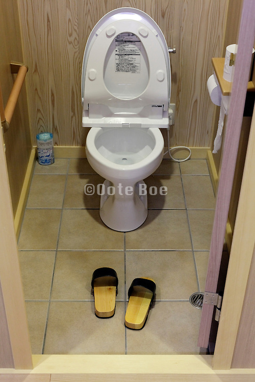 toilet room with slippers